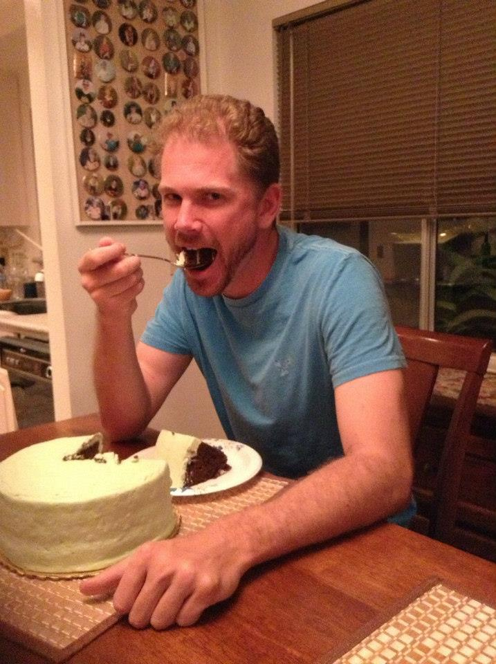 Zeb Welborn eating a Daisy Cake from Kim Nelson Explore Your Options